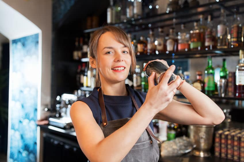 This photo shows a woman bartender demonstrating her shaking technique. Everyone develops their own style. (© dolgachov/123RF photo)