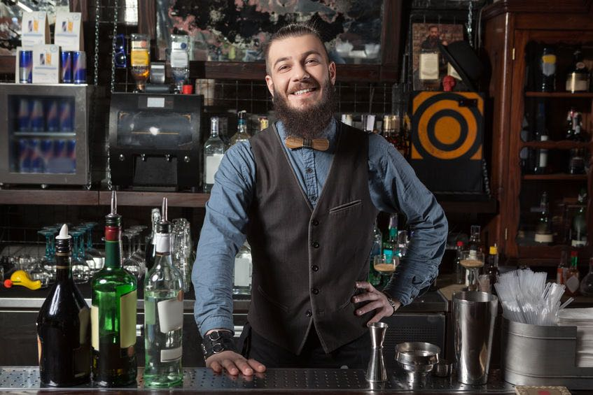The purpose of this photo is too showcase the smile, attitude and genuine desire of the bartender to serve the customer. (© luckyraccoon/123RF photo)