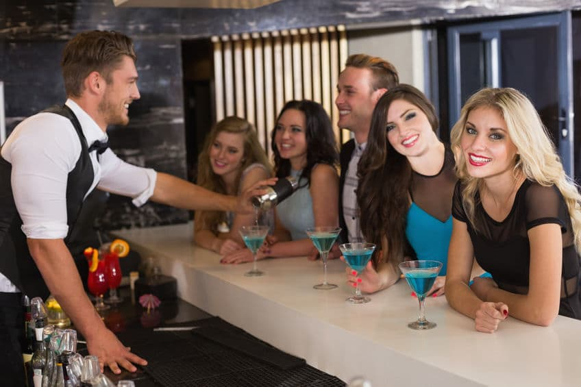 This photo shows a bartender with a group of repeat customers that have also become friends. To do the job you must genuinely enjoy people and the many personalities that you'll encounter. (© XXXXXXXXXX/123RF photo)