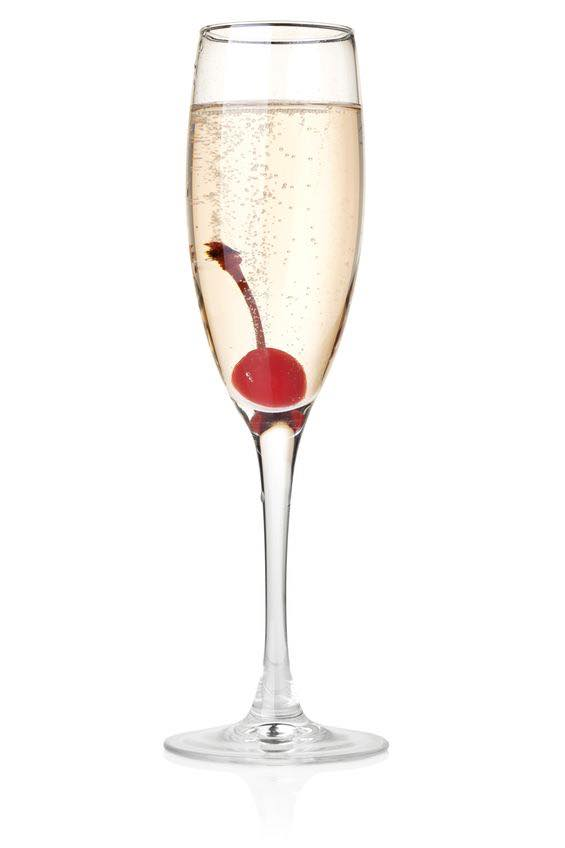 Photo shows a French 75 cocktail in a serving glass, mixed and ready to drink. (© karandaev/123RF photo)