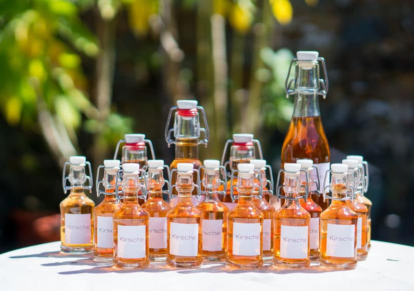 This photo demonstrates how beautiful homemade liqueurs can be, when filtered and bottled to give to guests as gifts. (© gedankenspieler/123RF photo)