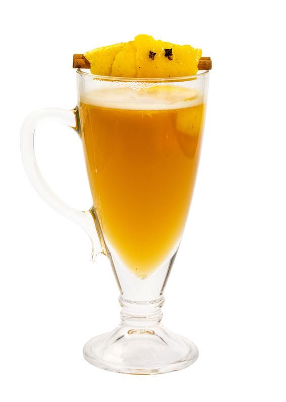 Photo shows a Hot Buttered Rum cocktail in a serving glass, mixed and ready to drink. (© lestertair/123RF photo)