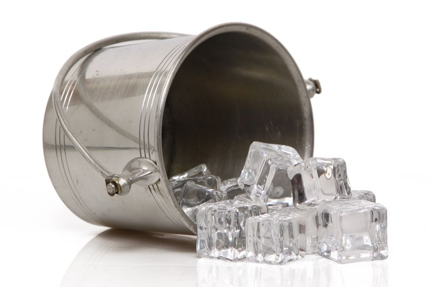A photo of an ice bucket, that is tipped over with the cubes spilling out, shows the importance of always having lots of ice for entertaining. (© twoellis/123RF photo)