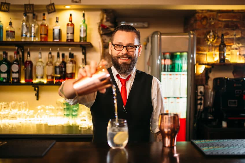 This photo shows a confident working bartender that has mastered all the mixology, ingredients, tools and techniques, that go into making delicious cocktails with repeatable quality and tight portion controls. (© nomadsoul1/123RF photo)