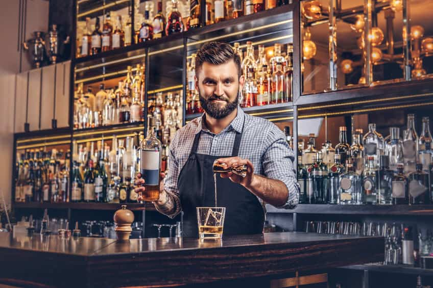 This photo demonstrates a confident bartender that has memorized all the master drink themes, which means that memorizing individual drink recipes isn't required. (© fxquadro/123RF photo)