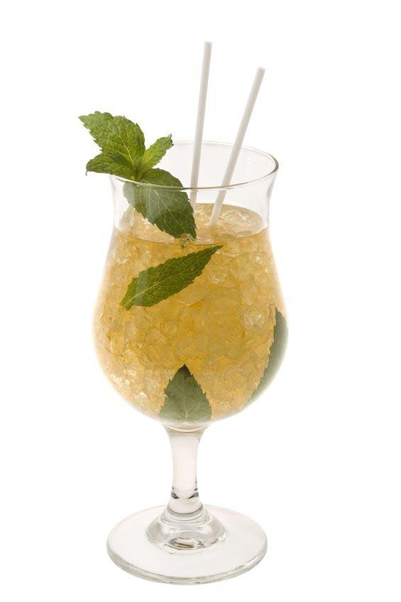 Photo shows a Mint Julep cocktail in a serving glass, mixed and ready to drink. (© gpalmer1477/123RF photo)