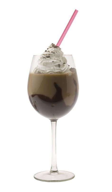 Photo shows a Mudslide cocktail in a serving glass, mixed and ready to drink. (© gpalmer1477/123RF photo)