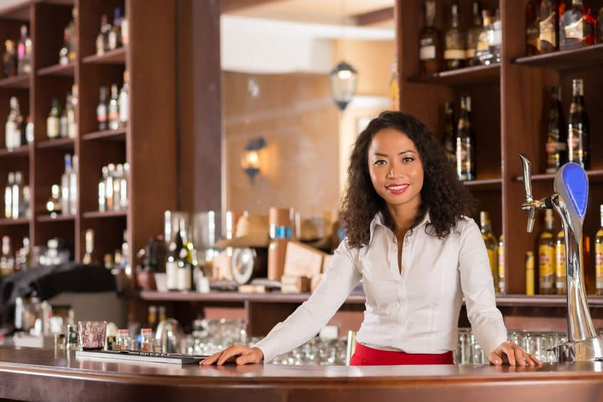 This photo from a high end cocktail lounge shows that women can achieve head bartender status just as easily as men can. (© dragonimages/123RF photo)
