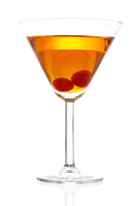 Photo shows the bartender how a Rob Roy cocktail looks when mixed and ready to serve to the guest. (© iodrakon/123RF photo)